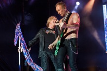 BARCELONA, SPAIN - JUNE 24: Joe Elliott and Phil Collen of Def Leppard perform on stage at Poble Espanyol on June 24, 2013 in Barcelona, Spain. (Photo by Jordi Vidal/Redferns via Getty Images)